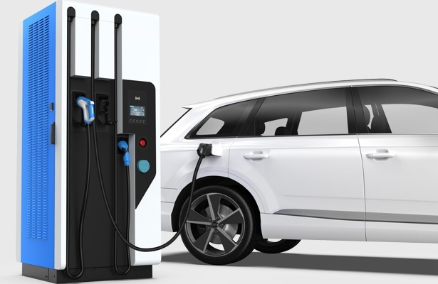 Fast electric vehicle charger with intermediate energy storage