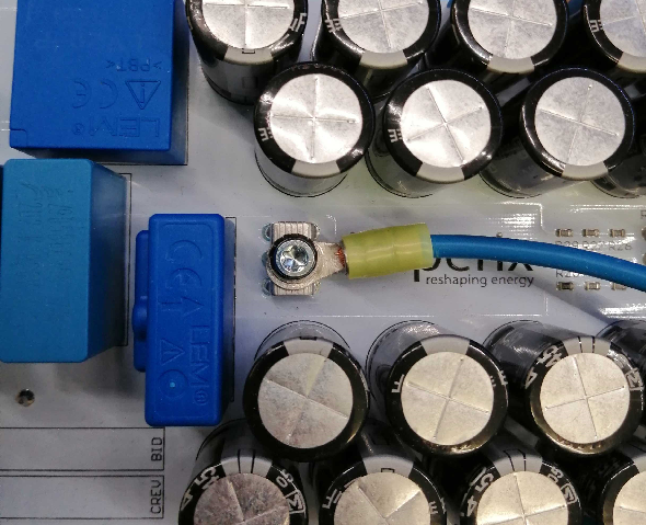 AC power terminal connection with a ring cable shoe